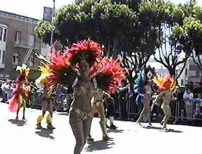 Dancers wearing golden outfits.